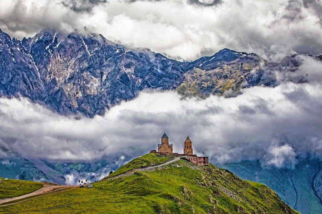 gergeti-trinity-church-caucasus-mountains-e1460572342713